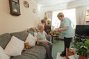Casi resident in their home with member of staff
